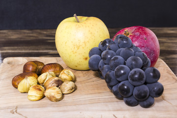 apple, grapes and chestnuts, autumn concept