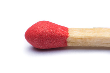 Close-up red match isolated on a white background
