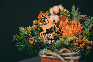 Christmas floral composition. a New Year's bouquet with a deer