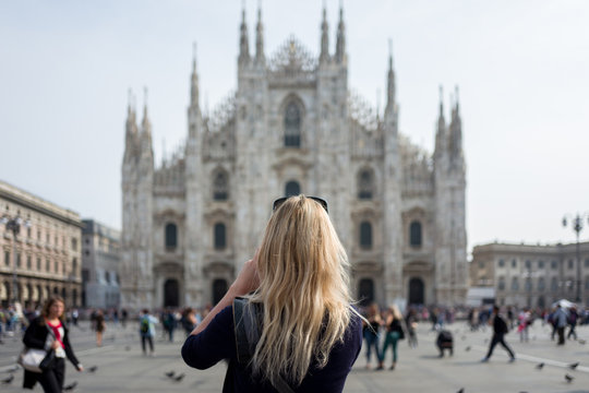 blonde girl in front of Milan Cathedral