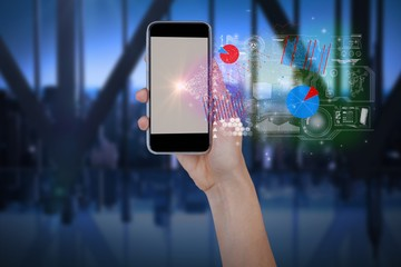 Composite image of hand holding mobile phone with room in