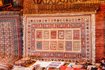 Turkish carpet in the storefront is on sale in the bazaar market