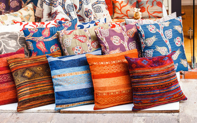 Colorful arabic pillows at sales counter at Turkish market