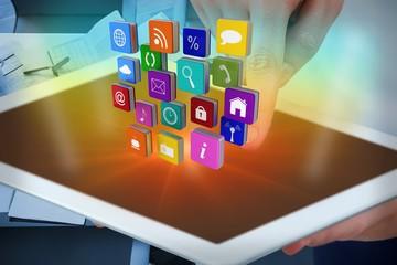 Composite image of hands using digital tablet with digital
