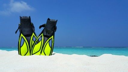 P01896 Maldives white sandy beach fins snorkel mask scuba flippers on sunny tropical paradise island with aqua blue sky sea ocean 4k