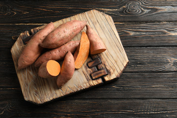 Sweet potatoes on wooden board