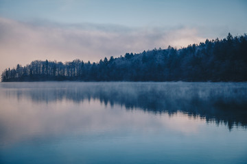 Panoramic morning mist over Lake Bohinj, Slovenia. Concept Winter Landscape.