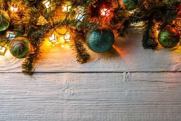 Photo of fir branches, Christmas balls, burning garland
