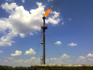 Flare for flaring associated gas. The end point of the pressure
