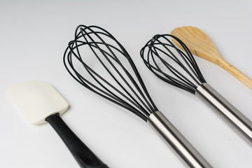 Assorted Kitchen Utensils on White Background Cropped Close Perspective View