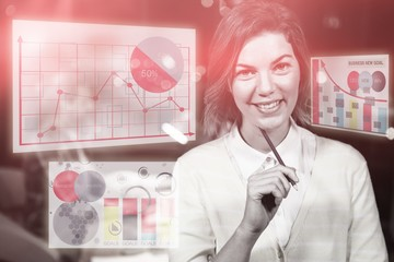 Composite image of woman smiling against colored graph