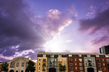 Composite image of colored houses against purple sky