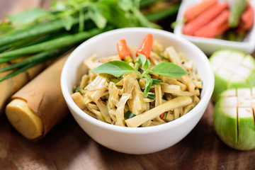 Northern Thai food (Yum Nor Mai),spicy bamboo shoot salad with crab paste on wooden background