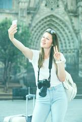 Enthusiastic female tourist making selfie