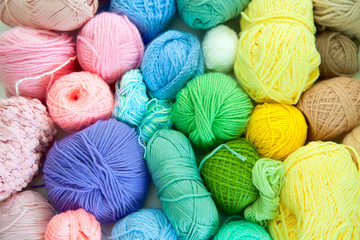 Colored yarn of iridescent hues. Woolen threads.