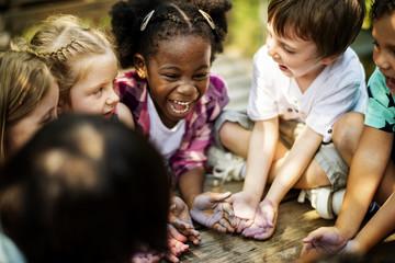 Kids having a fun time together Fotoväggar