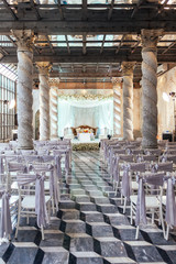Wedding ceremony place with stage and seats for guests with exotic design in Bangkok, Thailand.