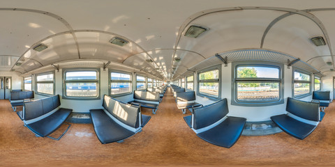 3D spherical panorama with 360 viewing angle. Ready for virtual reality or VR. Full equirectangular projection. Interior of train with seating econom class.