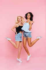 Full length image of two happy women in summer clothes