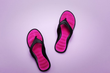 Pink flip flops on purple background