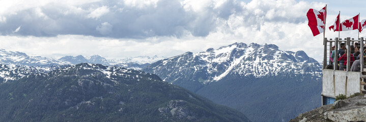 Top of Whistler Gondola Ride with Canada Flag by Mountain Range View