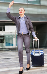 Adult woman worker going with baggage