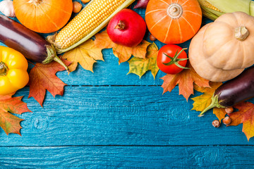 Image of blue wooden table with autumn vegetables