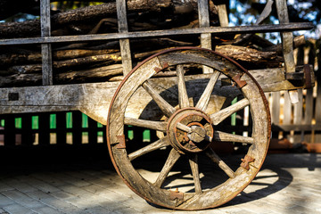 Old wooden cartwheel from close-up. Vintage farm wagon