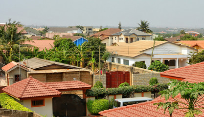 Modern residential buildings in Africa. Modern view. Suburb lifestyle in developing countries. Beautiful urban landscape. Top view. Wonderful houses with red tile roofs.