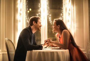 Fototapeta Sweet couple having a romantic dinner obraz