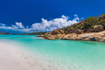 Rocks on Whitehaven Beach with white sand in the Whitsunday Islands, Queensland, Australia