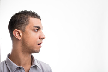 Profile view of young man against white background