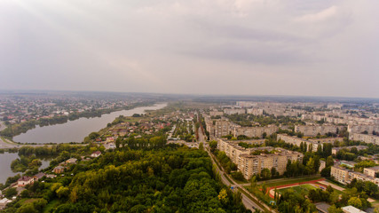Arial view of a beautiful landscape of a park, a city and a lake.