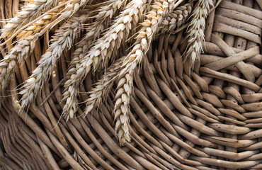wheat flakes on the background of a wicker basket
