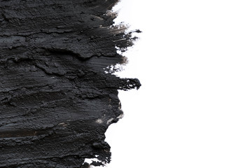 Black volcanic cosmetic clay texture close up. solution of cosmetic clay abstract background. Fototapete