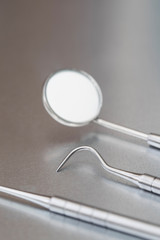 Close Up Of Dental Instruments On Metal Surface
