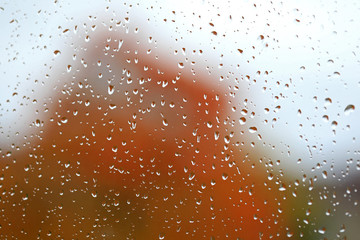 Raindrops on Window in Autumn