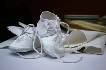 Newborn baby shoes, elegant, white colored for christening