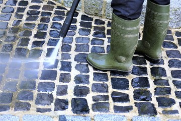 An Image of walkway cleaning - high pressure cleaner