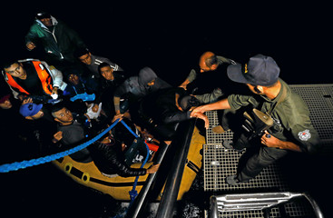 A group of Tunisian migrants arrive on a rubber boat after being rescued by the Tunisian navy off the coast of Bizerte