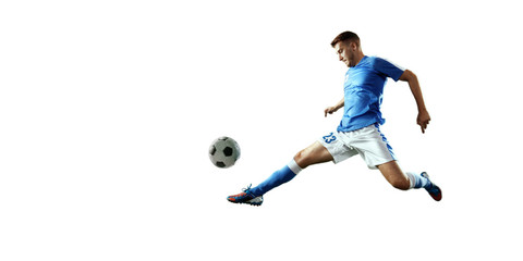 Soccer player performs an action play and beats the ball. Isolated football player in unbranded sport uniform on a white background.
