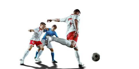 Soccer players fight for the ball. Isolated football players in unbranded sport uniform on a white...