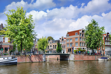 Renovated mansions at Amsterdam ancient canal belt, The Netherlands