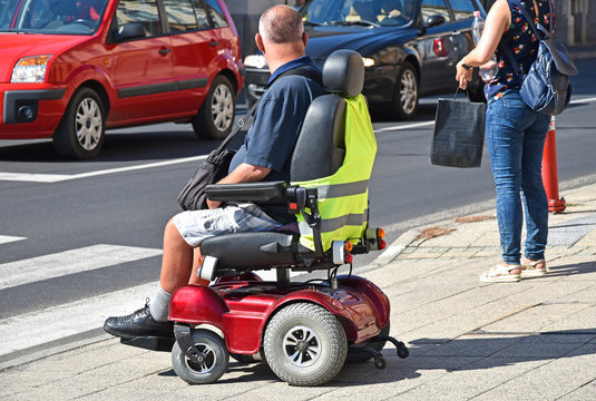 Man with an electric wheelchair