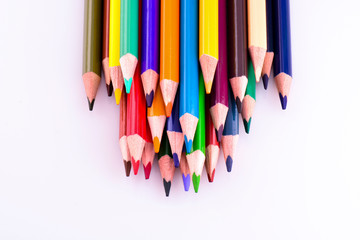 Color pencils on white background. Different colored pencils