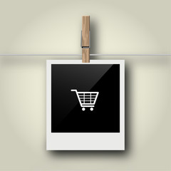 Sofortbild mit Symbol an Wäscheleine - Einkaufswagen