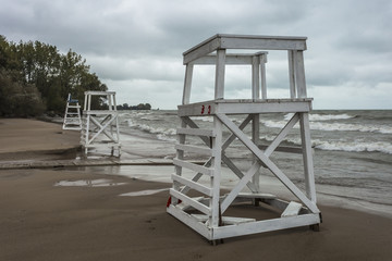 Lifeguard stands monitoring the beach as waves crash