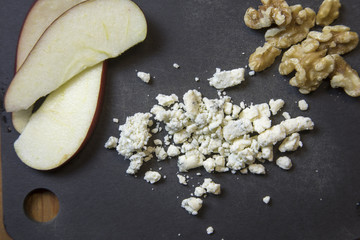 Blue cheese crumbles with apples and walnuts