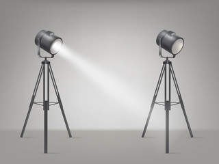 Theater, cinema, studio beaming spotlights on a tripod realistic vector illustration. Turned on and off cine lighting units, lightning equipment for performance or premiere stage illumination
