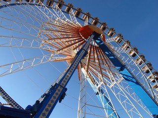 Ferris wheel against bright blue sky backdrop